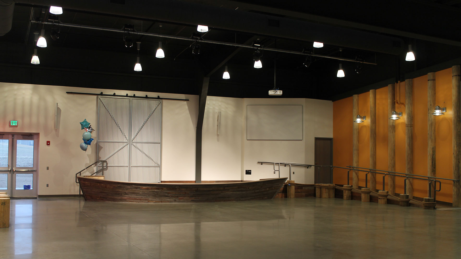 Stage designed as boat with ramp in WE Kids area at The Water's Edge Church in Omaha, NE